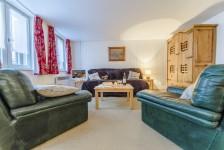Salon rustique d'un appartement de deux pièces à Val d'Isère